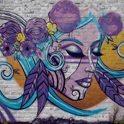Wall murals brick wall witth graffiti and graffiti female face
