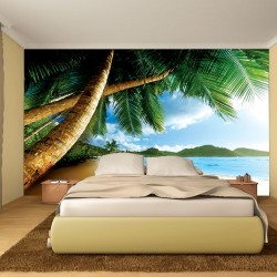 Photo mural close view with palms and a shore