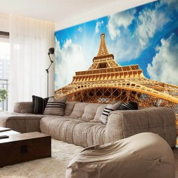 Wall murals Eiffel tower view from below background clouds