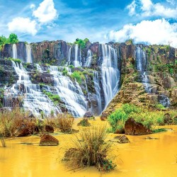 Photo mural colorful exotic waterfall in yellow and blue colors
