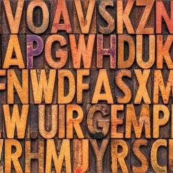 Wall murals Art wall of wooden letters in 2 shades