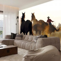 Wall mural with wild horses and a cowboy